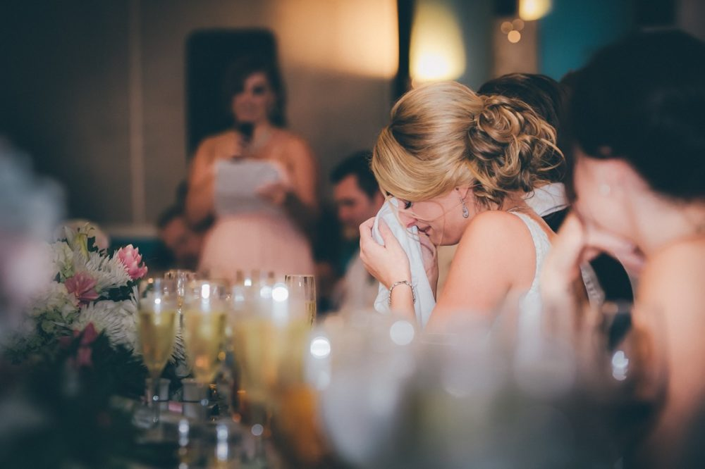 emotional bride pictures during speeches