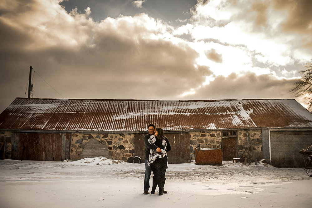photo in front of stone barn with sun light shining through clouds in Owen Sound
