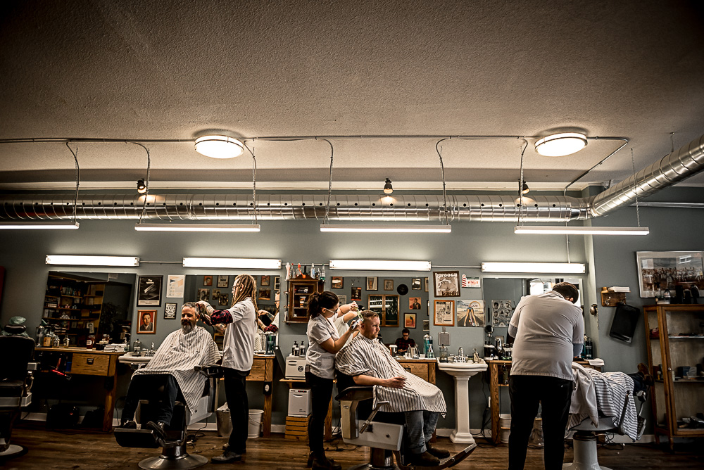 The groom getting a shave on the morning of his wedding day at The History Barber Shop Co.