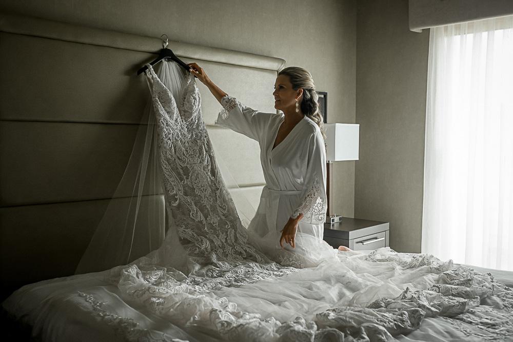 bride getting dress down