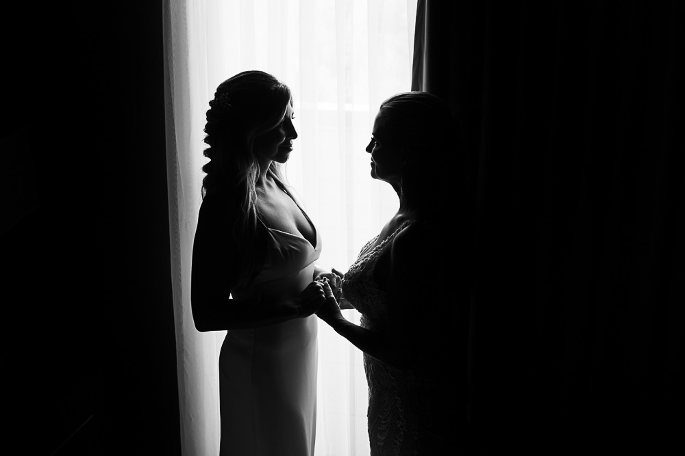 mother daughter moments in front of window