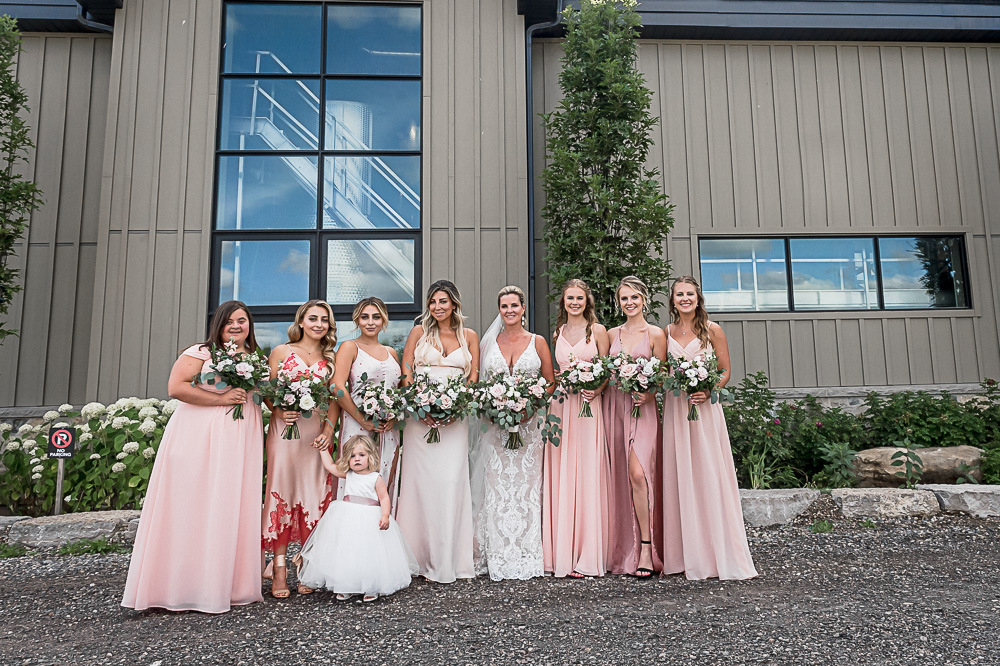 wedding party photos in front of Adamo