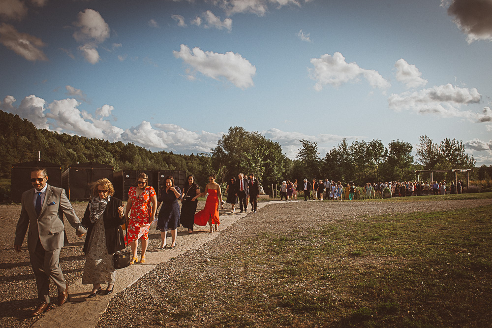 wedding guests leaving ceremony in single file