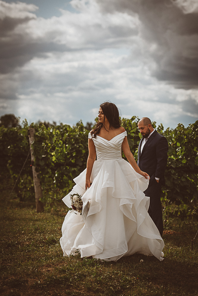 bride groom separated in vineyard