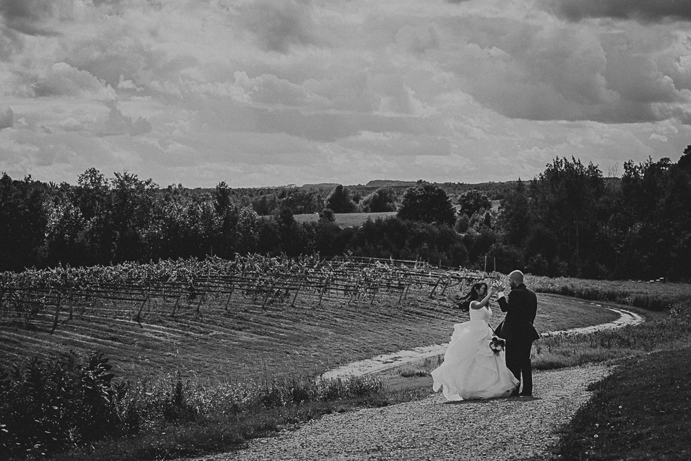 BW portrait of bride groom on hill