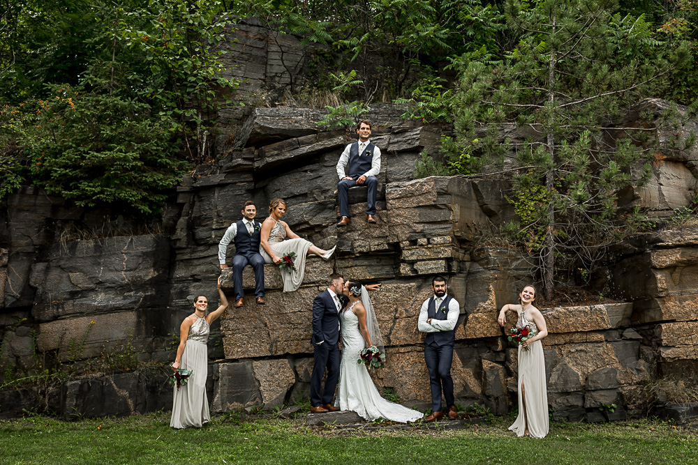 wedding party photo with rock wall