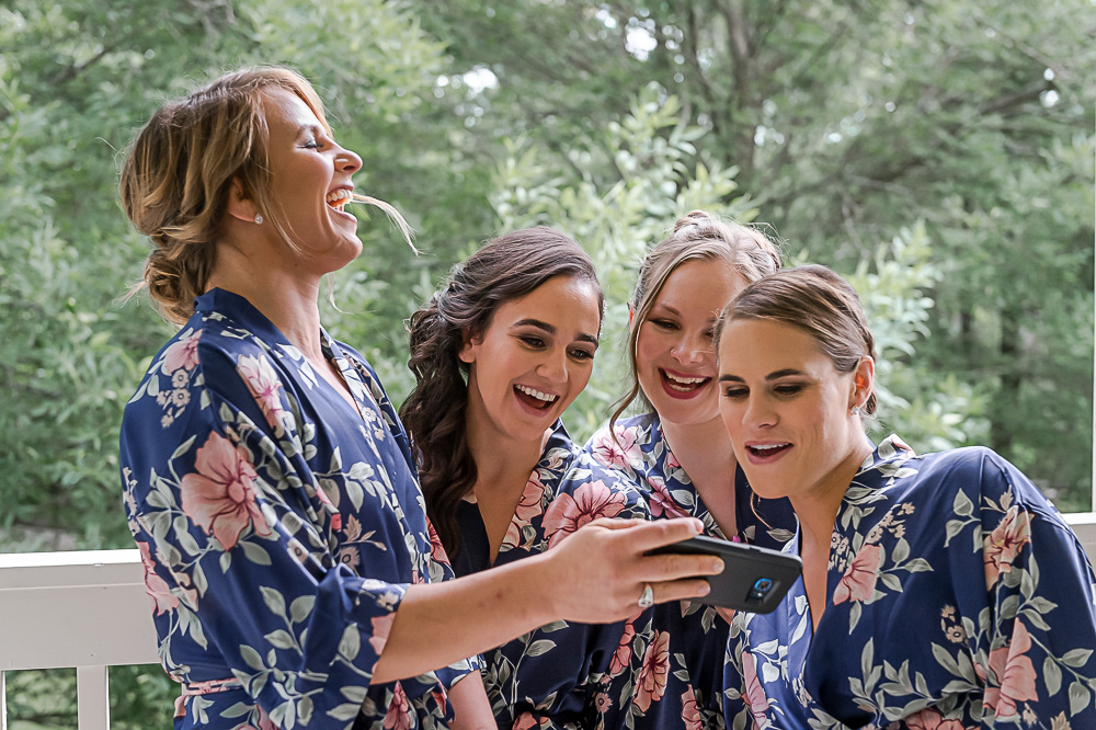 bridesmaids in robes taking selfies