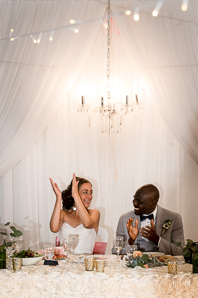bride clapping during speeches