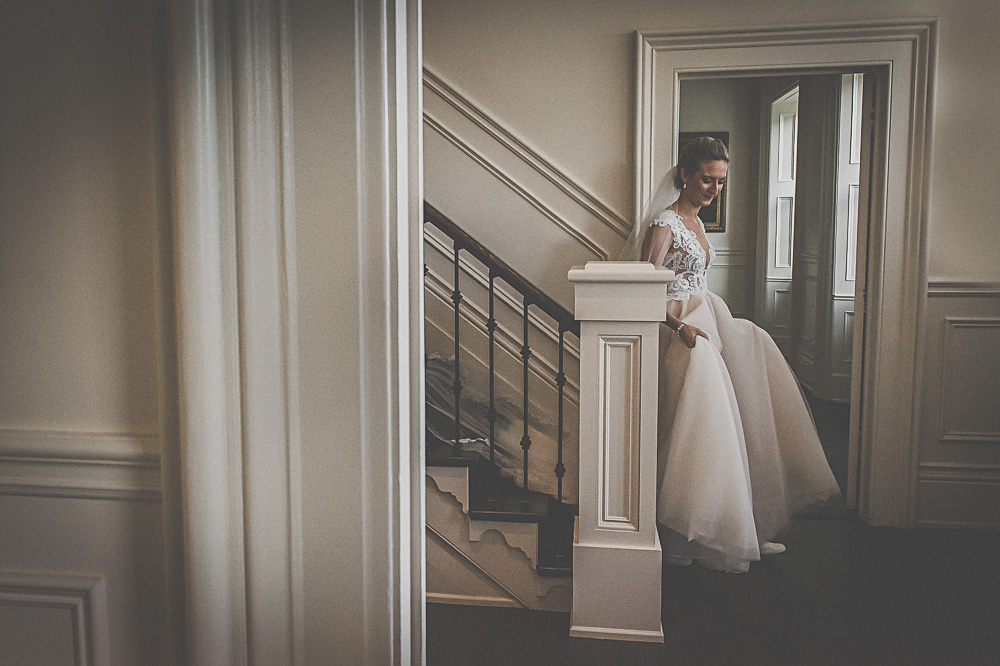 bride coming down the stairs