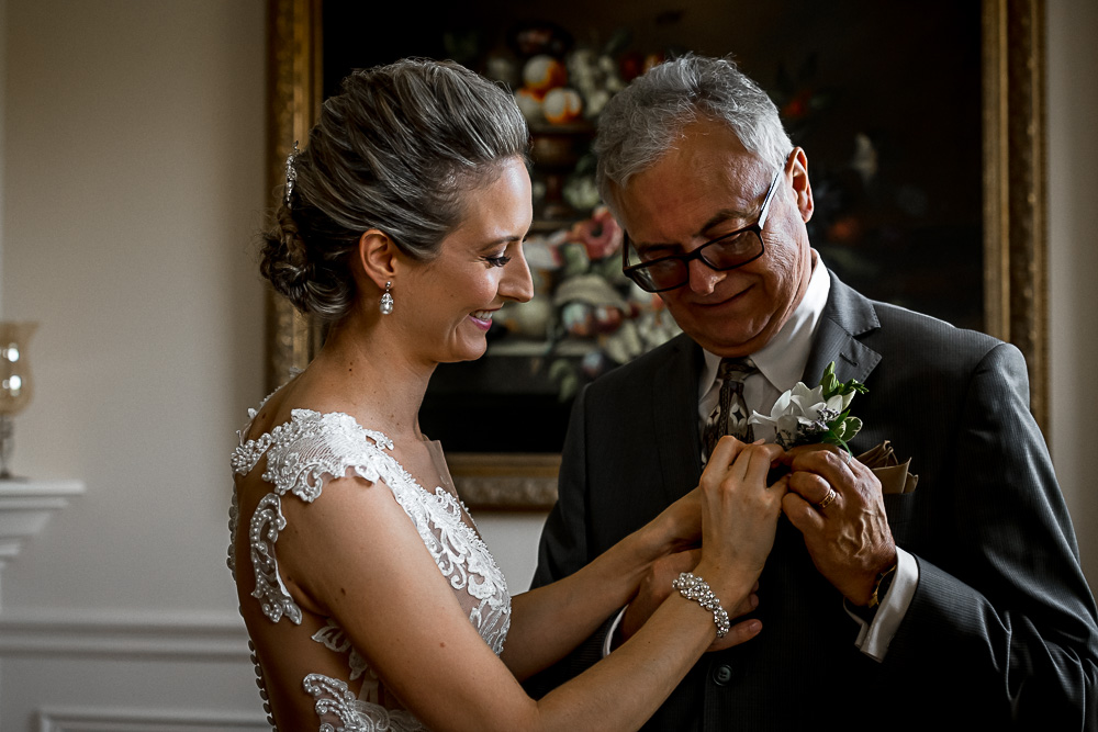bride helps dad with flowers